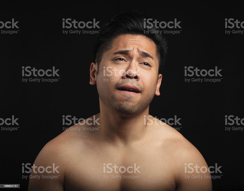 Crying asian man stock photo
