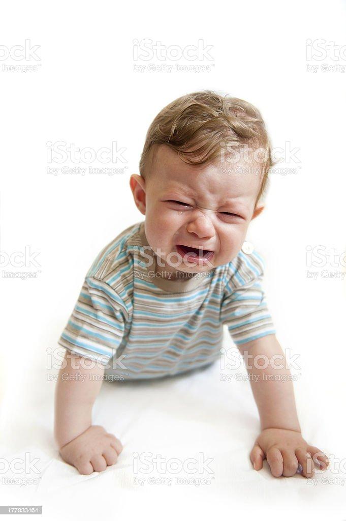 Crying baby boy on white background. royalty-free stock photo