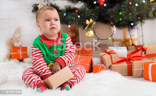 istock Crying baby elf missed his Christmas gift 1187331506