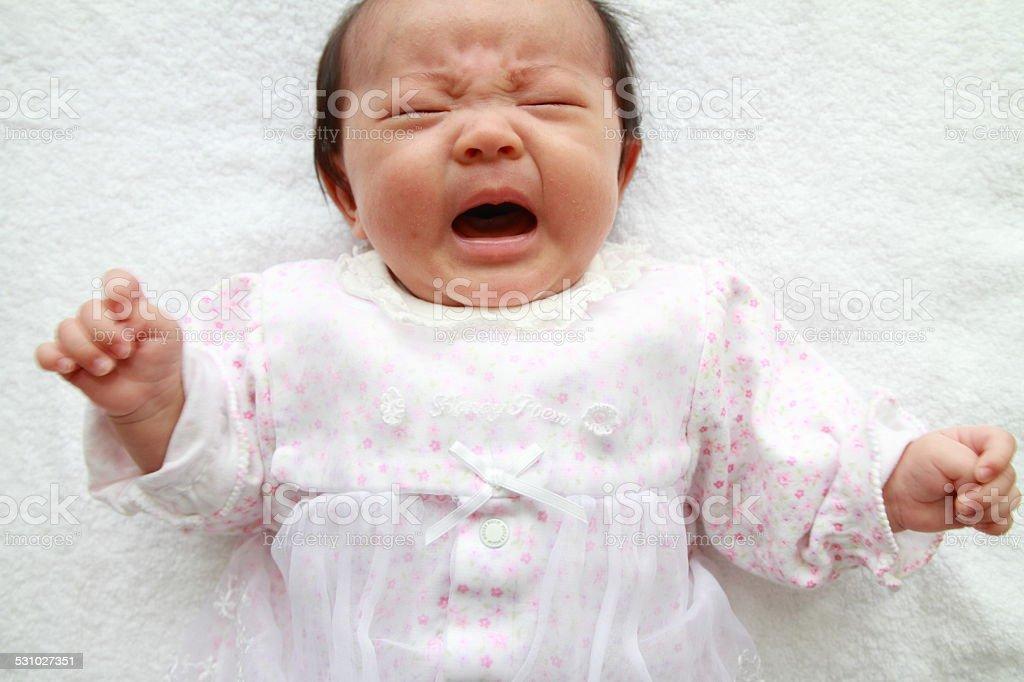 Crying baby girl (Japanese 0 year old) stock photo