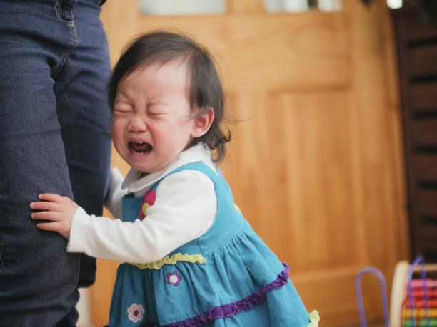 crying baby girl stock photo
