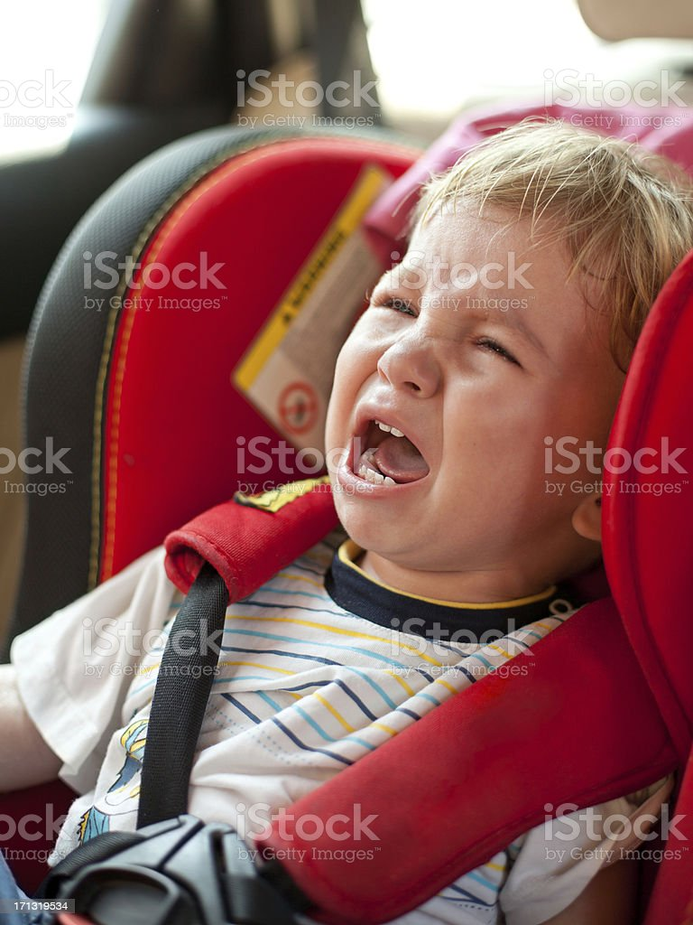 Crying baby in the car stock photo