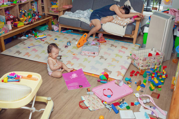 crying baby, little girl's daily life baby girl crying on the floor surrounded by toys kids cleaning up toys stock pictures, royalty-free photos & images