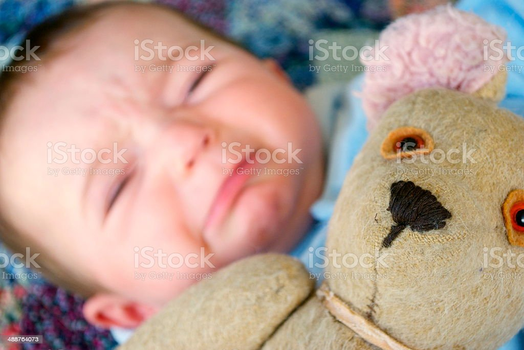 Crying Baby with Bear royalty-free stock photo