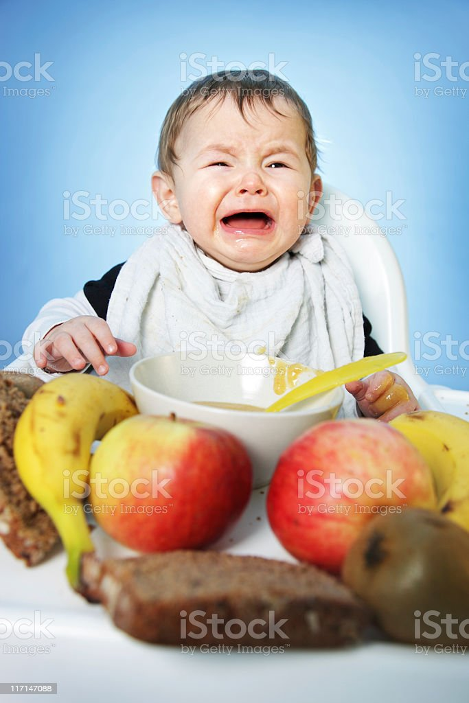 Crying Baby with Healthy Food stock photo