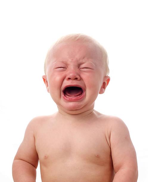 Crying boy isolated on white stock photo