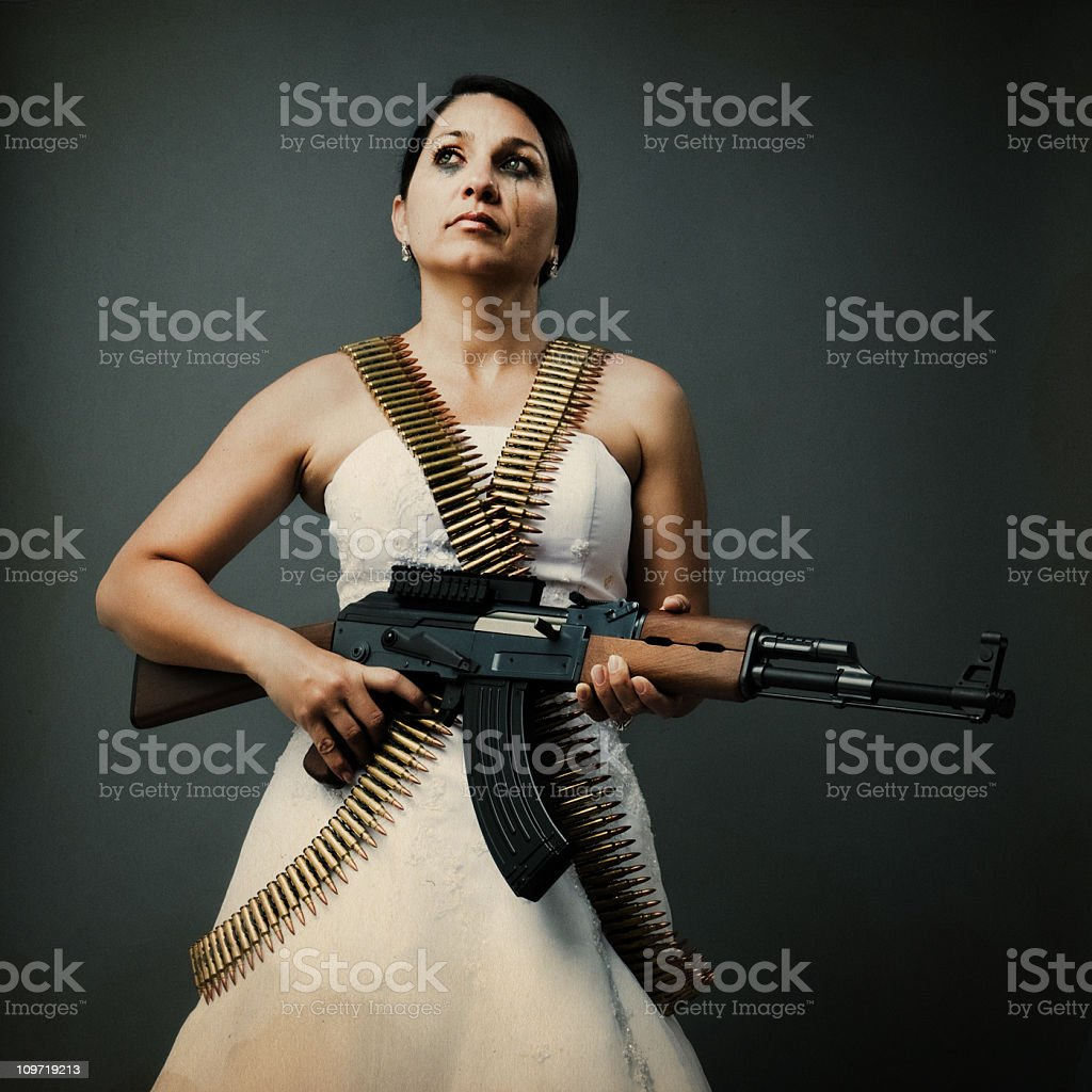 crying bride with an ak-47 stock photo
