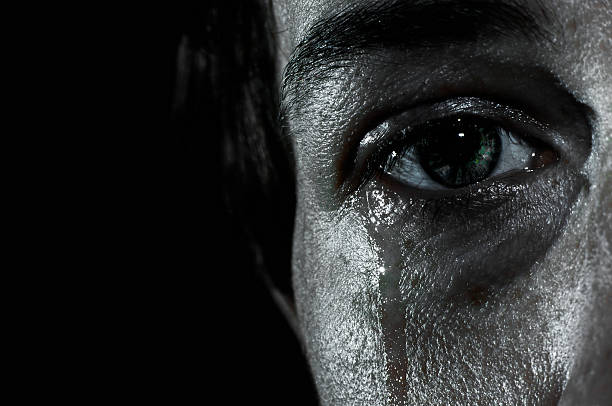 crying female eye - grief stock photos and pictures