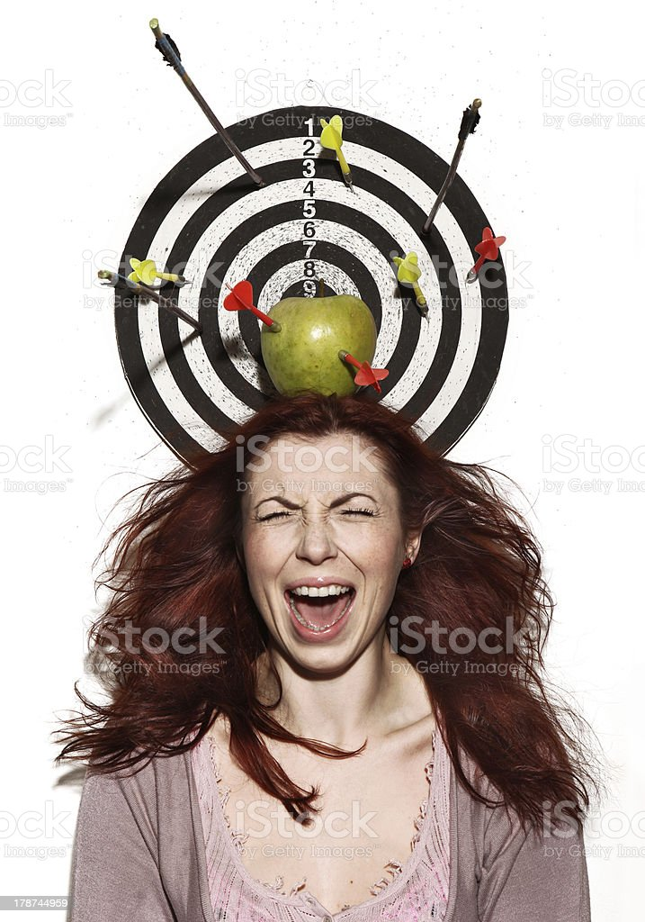 crying girl portrait with apple, darts and arrows stock photo