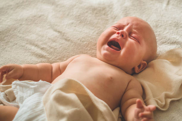 Crying hungry newborn baby lying on the bed love baby newborn baby picture id1166365914?b=1&k=6&m=1166365914&s=612x612&w=0&h=wmjld3b0ruqthjdduhhrforkc9epku ywfcimuqwths=
