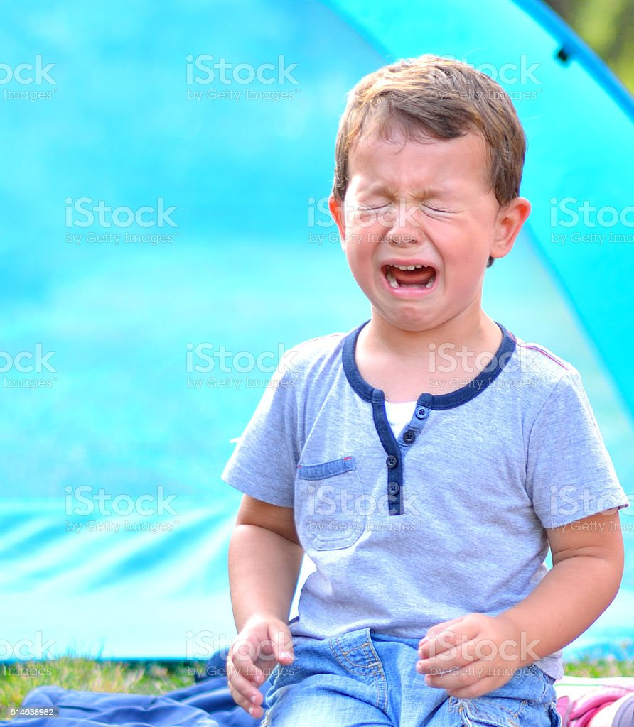 Crying Little Boy in the Park stock photo