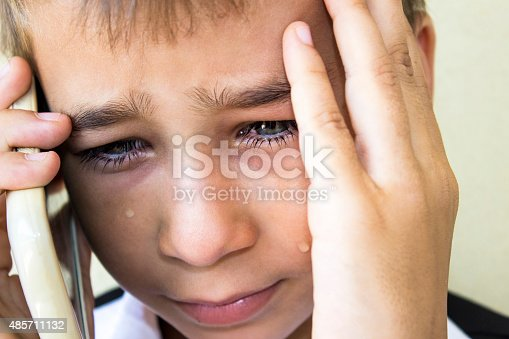istock Crying little boy talking on phone in pain 485711132