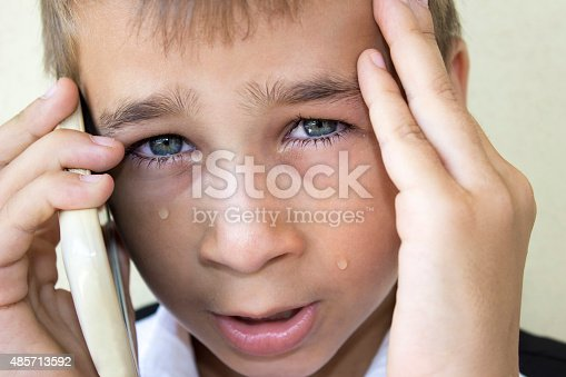 istock Crying little boy talking on phone in pain 485713592