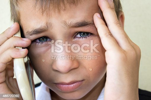 istock Crying little boy talking on phone in pain 485720260