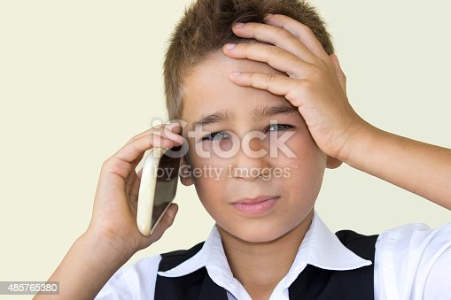 istock Crying little boy talking on phone in pain 485765380