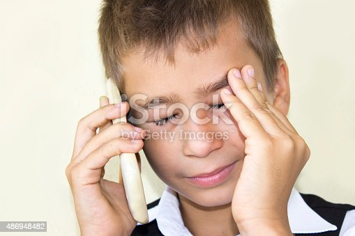 istock Crying little boy talking on phone in pain 486948482
