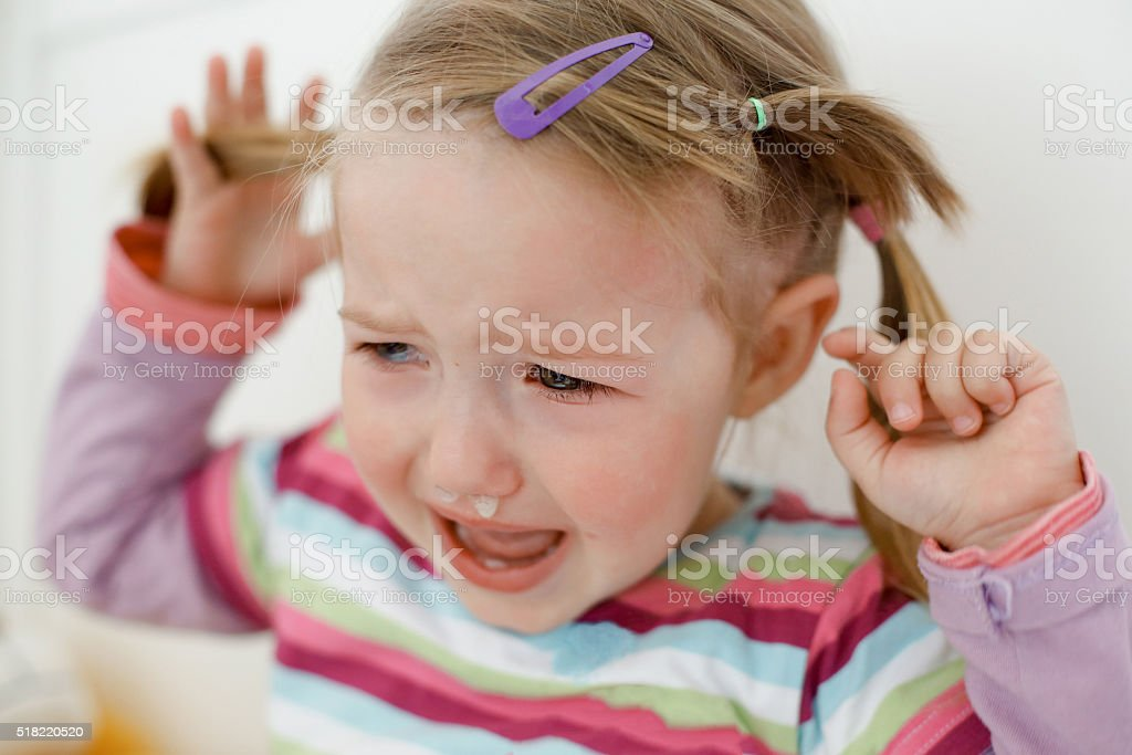 Crying little toddler, having a tantrum stock photo