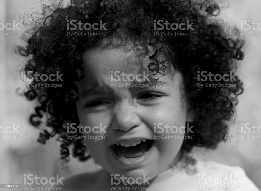 Crying Minority Child in Black and White stock photo