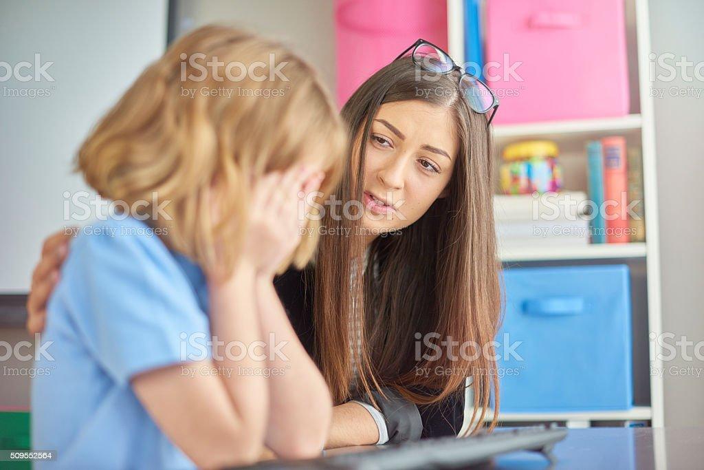 crying schoolgirl stock photo