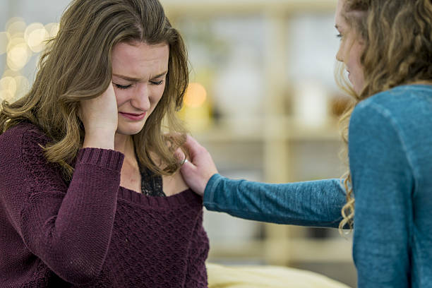 crying teenage girl - lila teenschlafzimmer stock-fotos und bilder