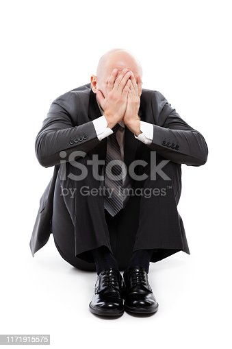 1162960006istockphoto Crying tired or stressed businessman in depression hand hiding face 1171915575