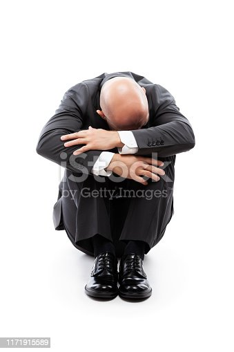 1162960006istockphoto Crying tired or stressed businessman in depression hand hiding face 1171915589