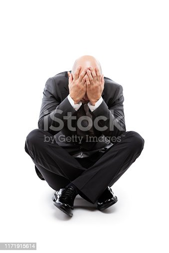 1162960006istockphoto Crying tired or stressed businessman in depression hand hiding face 1171915614