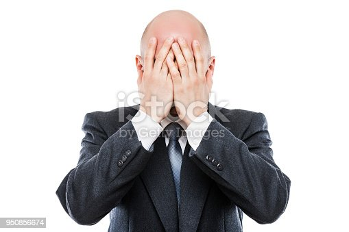 1162960006istockphoto Crying tired or stressed businessman in depression hand hiding face 950856674