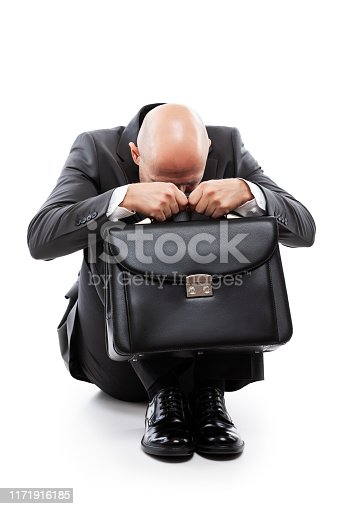 1162960006istockphoto Crying tired or stressed businessman in depression hand holding briefcase 1171916185