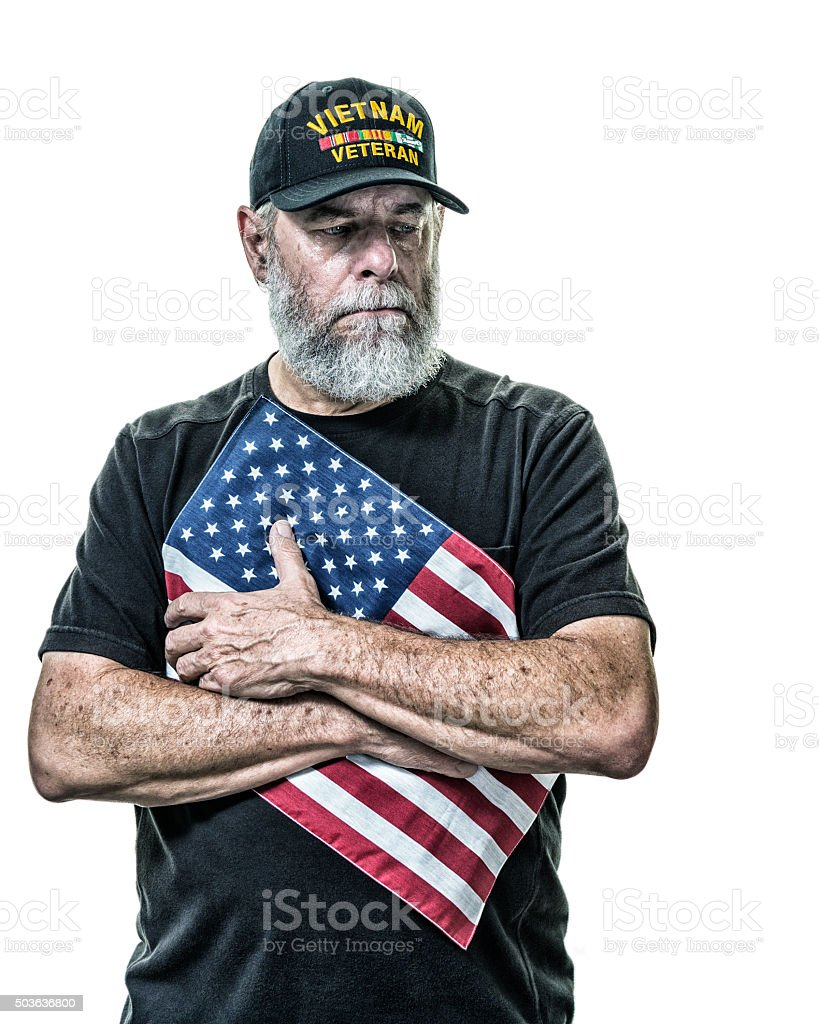 Crying Vietnam War United States Military Veteran Holding American Flag stock photo