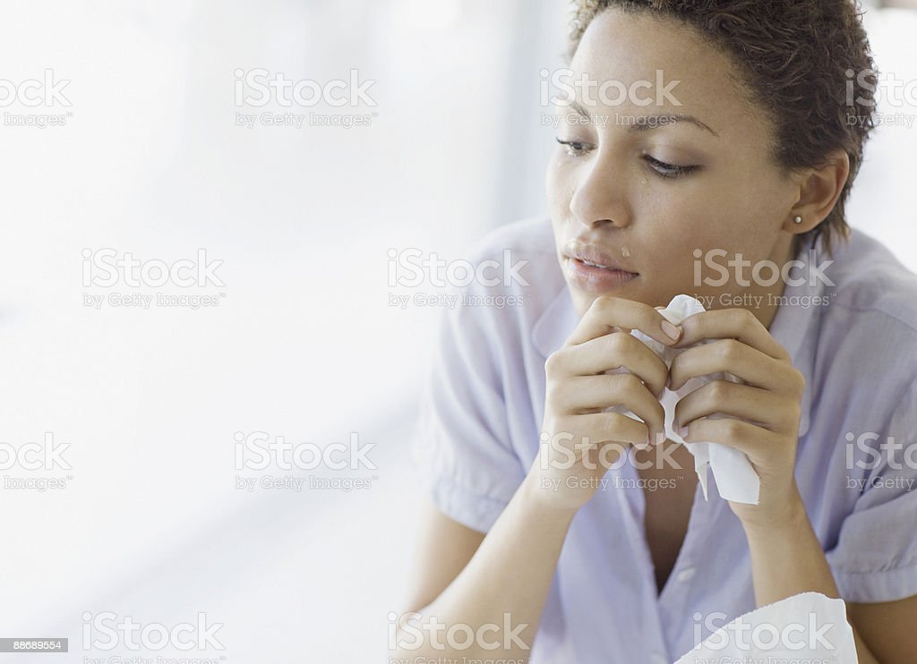 Crying woman holding tissue royalty-free stock photo