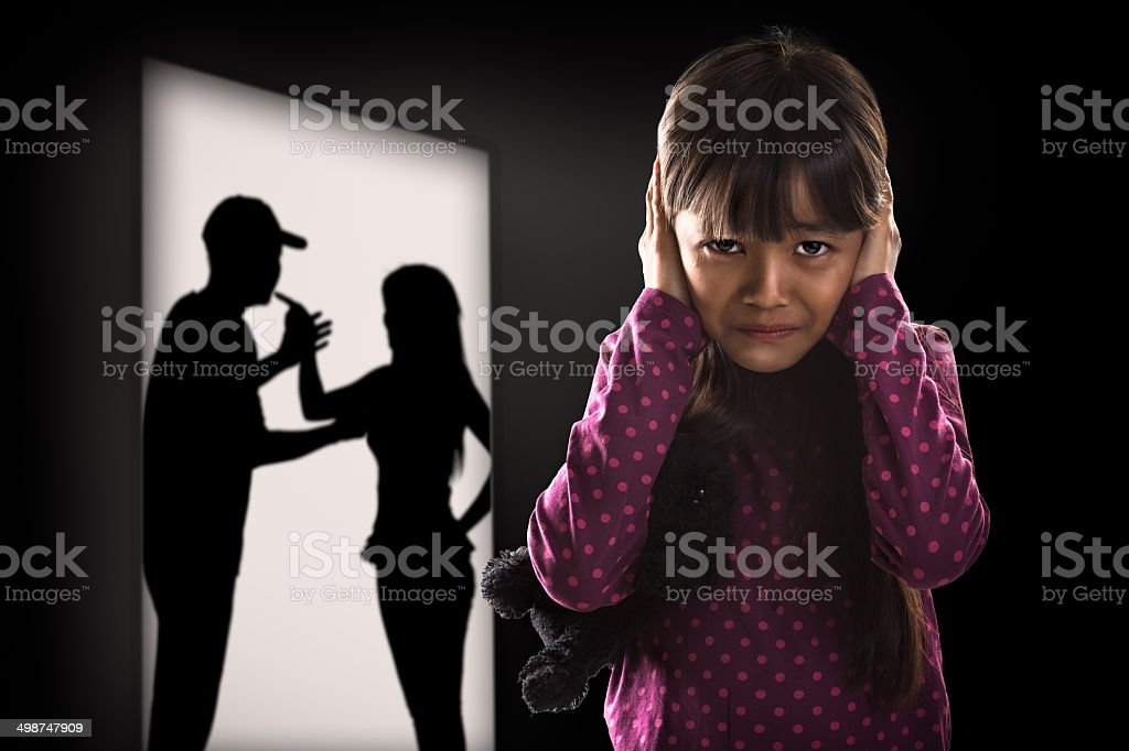 Cryling little asian girl tired of earing stock photo
