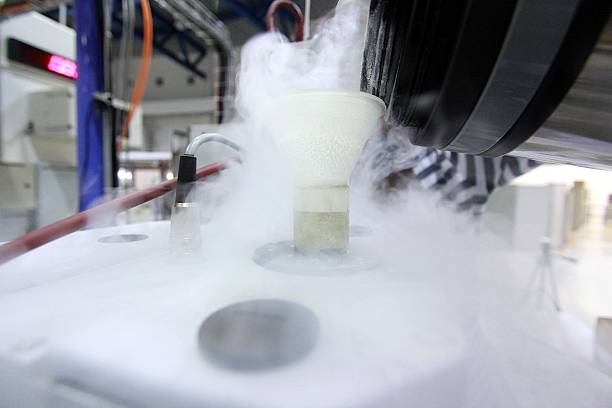 Cryogenic Liquid nitrogen steaming in a lab. liquid nitrogen stock pictures, royalty-free photos & images