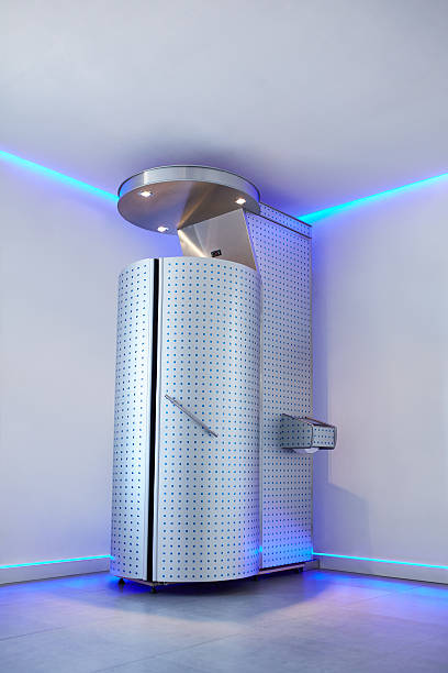 Cryotherapy capsule in cosmetology clinic Cryotherapy capsule in cosmetology clinic. Cryo sauna for whole body cryotherapy treatment. cryotherapy stock pictures, royalty-free photos & images