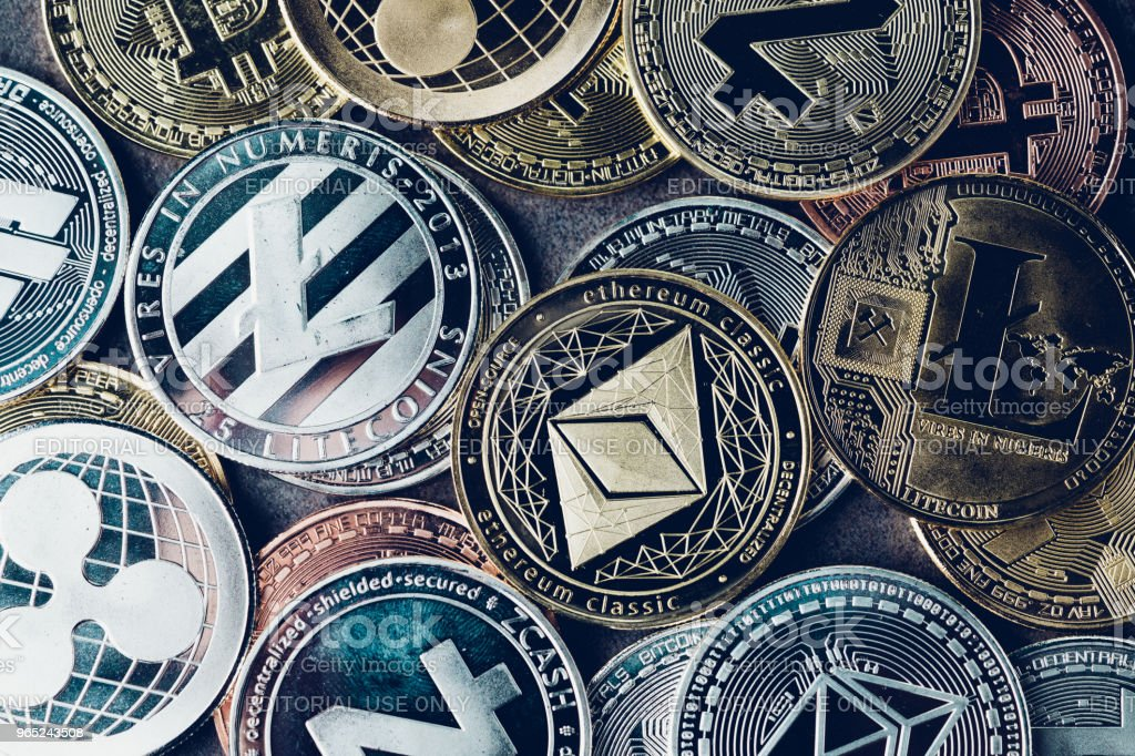Crypto currency background with various of shiny silver and golden physical cryptocurrencies symbol coins, Bitcoin, Ethereum, Litecoin, zcash, ripple stock photo