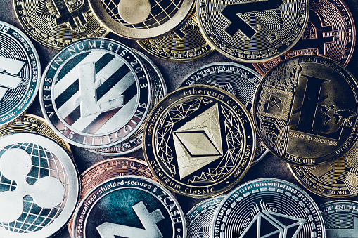 Crypto Currency Background With Various Of Shiny Silver And Golden Physical Cryptocurrencies Symbol Coins Bitcoin Ethereum Litecoin Zcash Ripple Stock Photo - Download Image Now