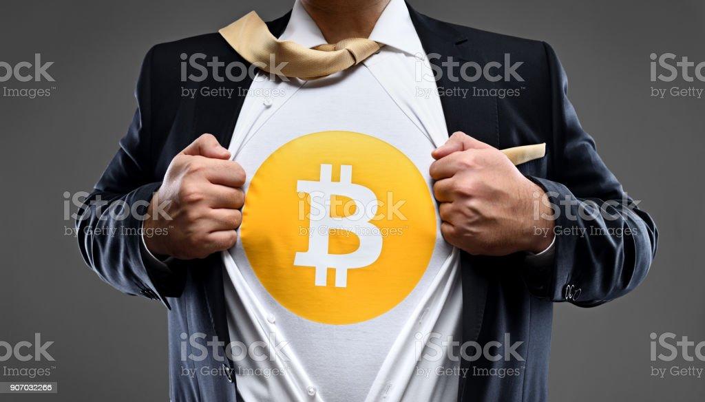 Crypto currency bitcoin super hero stock photo