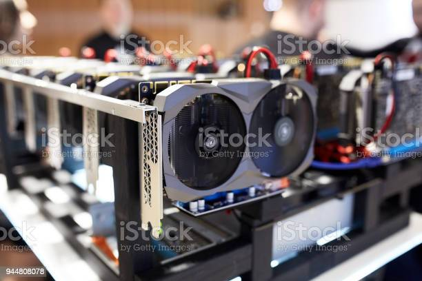 Crypto Currency Ethereum Mining Equipment Rig Lots Of Gpu Cards On Mainboard Graphics Processing Units Connected To Motherboard With Cables Server With Decryption And Encryption Computing Machines Stock Photo - Download Image Now