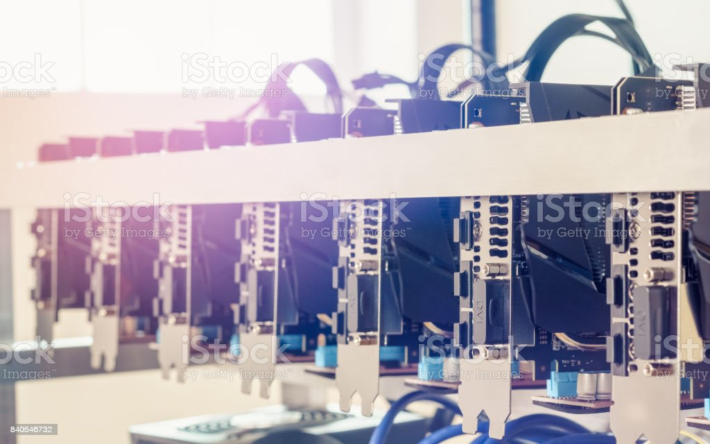 Cryptocurrency background (mining rig), Close up of array of GPUs for mining rig machine to mine for digital cryptocurrency such as bitcoin, ethereum and other altcoins. stock photo