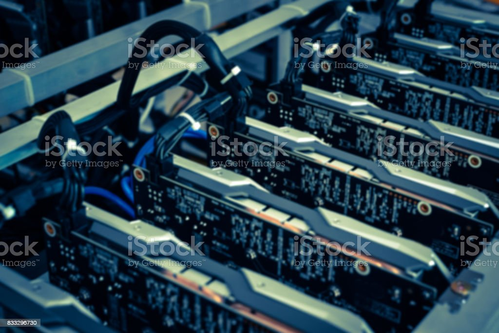 Cryptocurrency background (mining rig) - defocus stock photo