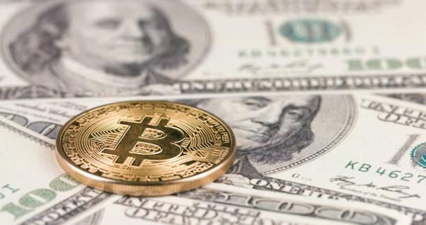 Cryptocurrency Bitcoin on USA dollar bills stock photo