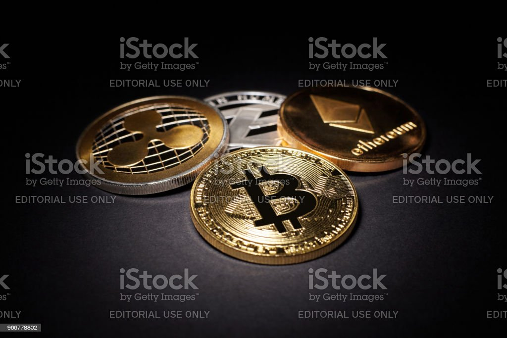 Cryptocurrency Coins: Bitcoin, Litecoin, Ethereum, Ripple on a black background stock photo