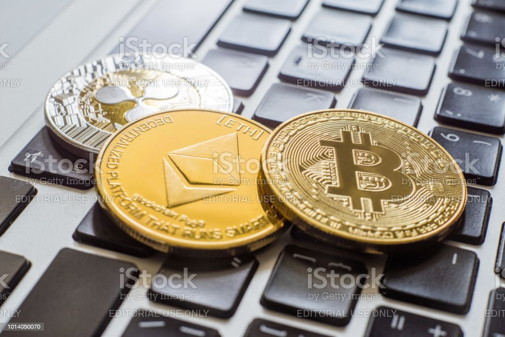 cryptocurrency coins - Ripple, Bitcoin, Ethereum stock photo