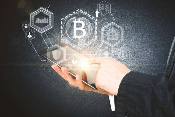 Cryptocurrency concept Businessman hands using tablet with abstract glowing bitcoin projection. Cryptocurrency concept. 3D Rendering initial coin offering stock pictures, royalty-free photos & images