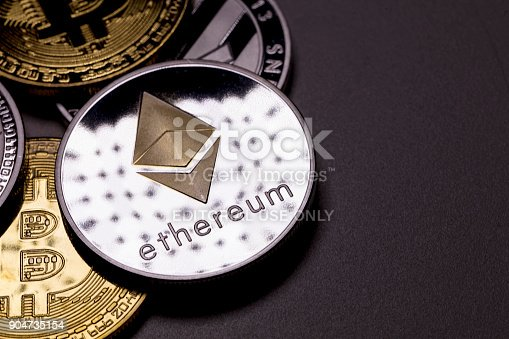 izmir, Turkey - January 12, 2018 Close up ethereum coin with other crypto coins shot in black background in studio