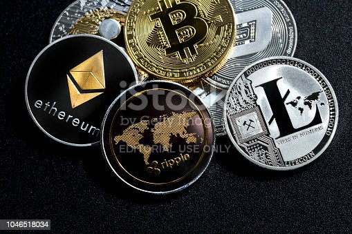 izmir, Turkey - September 28, 2018 Close up ethereum ripple litecoin bitcoin dash coins shot in metallic black background in studio