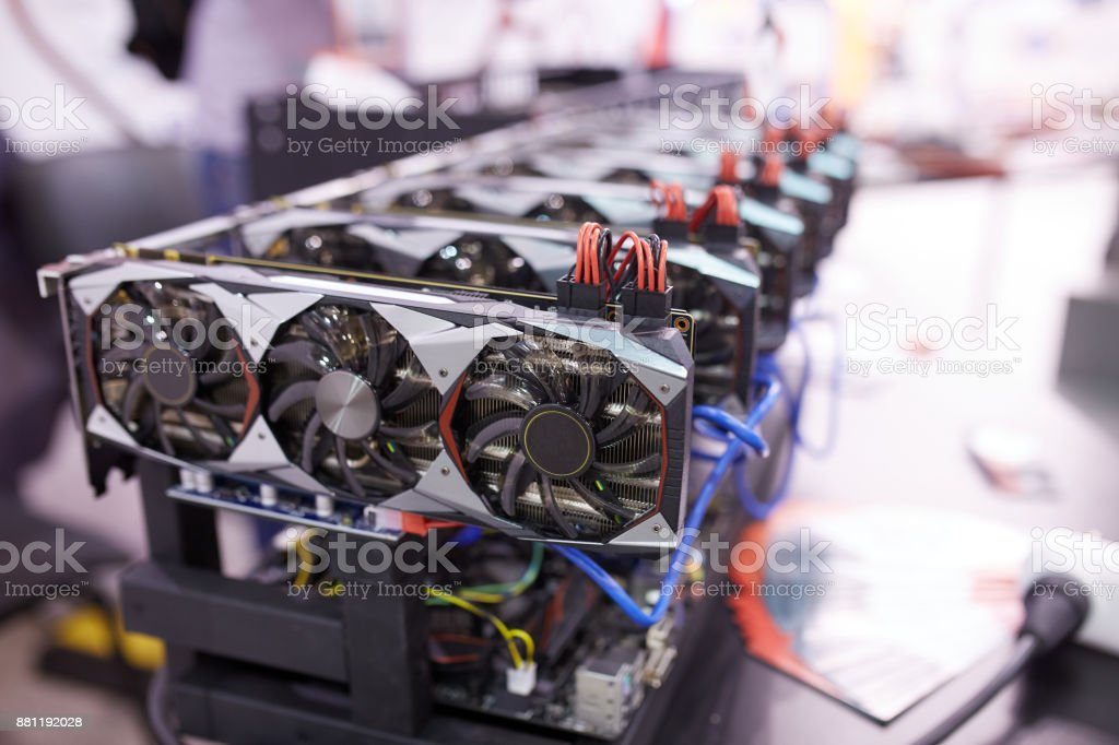 Cryptocurrency mining equipment - lots of gpu cards on mainboard stock photo