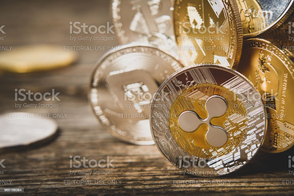 Cryptocurrency, souvenir coins of Ripple Monero Dash Litecoin Bitcoin Ethereum on wooden surface, macro with copy space for text zbiór zdjęć royalty-free