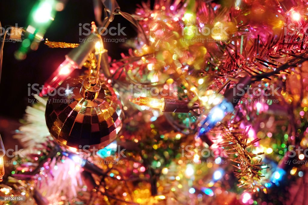 Crystal Ball And Golden Star Tree Decorated On Pine Tree On