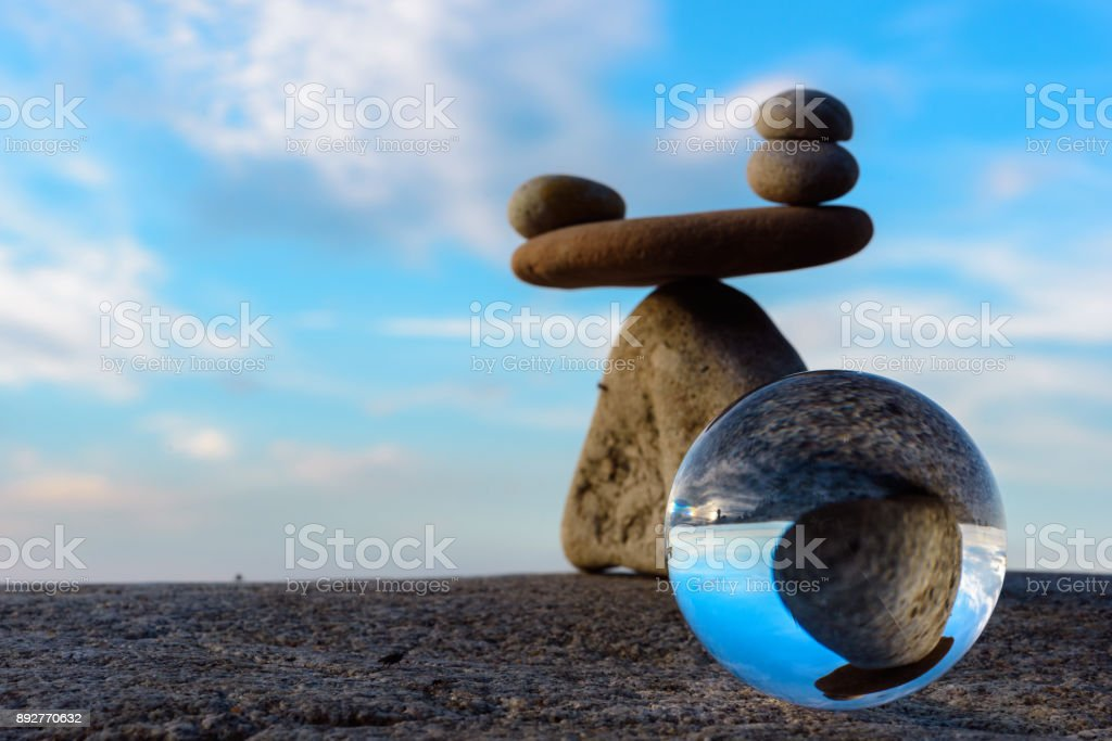 Crystal ball and stones stock photo